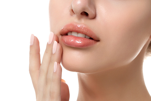 Close up of women's lips after receiving Juvederm